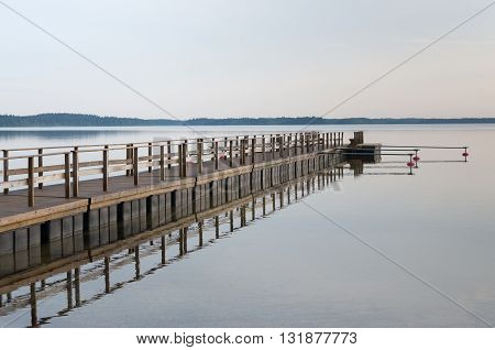 Wooded bridge in the port. Lithuania Plateliai