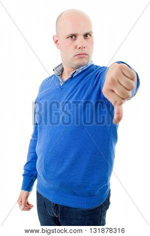 Casual man giving thumbs down, isolated on white background
