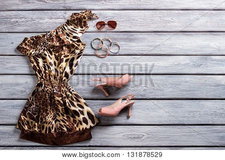 Leopard evening dress and heels. Sunglasses and bracelet set.