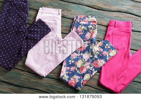 Blue pants with flower print. Dark navy folded trousers. Top quality items in showroom. Woman's pants from summer collection.