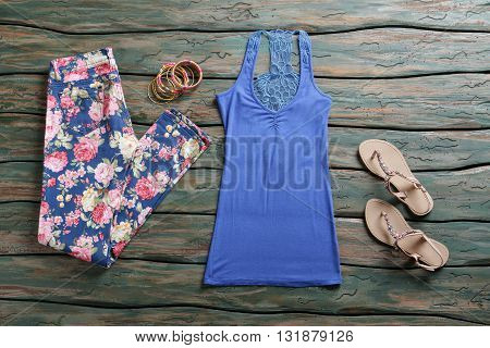 Blue tank top and pants. Sandals with top and trousers. Summer apparel from brand store. New design and quality materials.