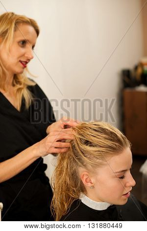 Hair Stylist At Work - Hairdresser Cutting Hair To The Customer Before Doing Hairstyle In A Professi