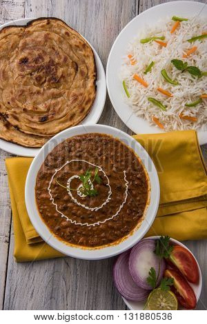 Dal makhani or dal makhni a Buttery Lentils made up of black gram, served with indian bread or chapati and rice