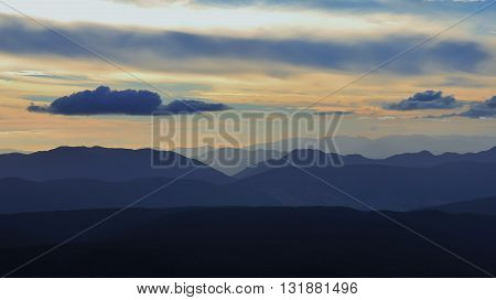 View from Mt Robert New Zealand. Clouds over mountain ranges at nightfall.