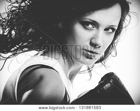 Sportsmanship fairplay and strong body. Young woman fighting boxing with opponent. Sport and fitness healthy lifestyle exercising. Black & white