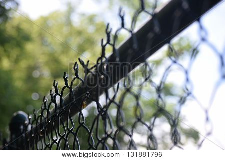 Fence in Perkiomenville Pennsylvania. It keeps people away from fishing in the creek.