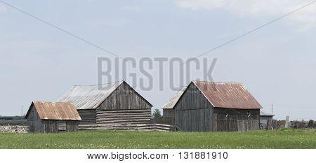 Decrepit barn in a farmers field in spring
