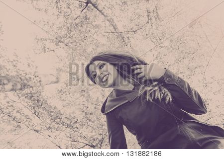 Nature outdoors concept. Young lady enjoying free time in the park.
