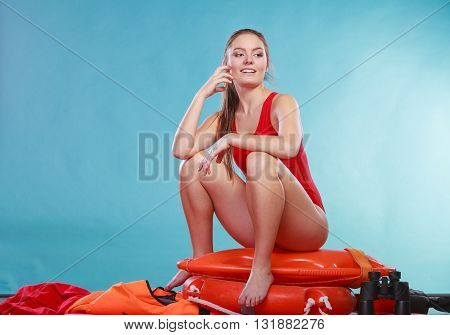 Happy Lifeguard Woman Sitting On Rescue Ring Buoy.