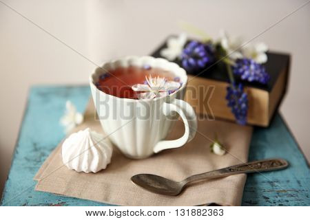 Cup of tea on wooden stool