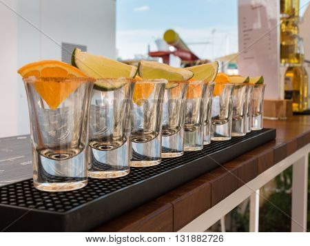 Little Glasses In Line With Orange And Lime Slices Ready To Tequila Shots