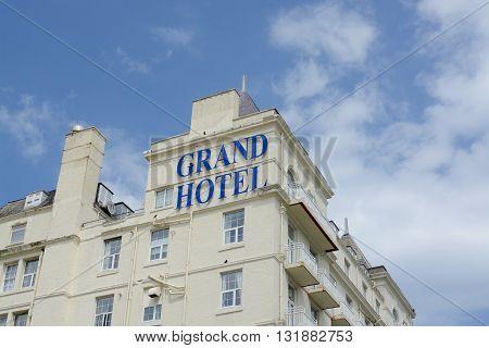 LLANDUDNO, UK - MAY 28, 2016: The Grand Hotel Llandudno overlooking the bay and promenade, Llandudno, Wales, UK