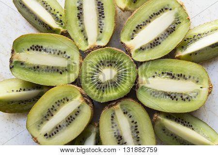 Fresh organic Kiwi Fruit Slices arranged showing the pips & structure