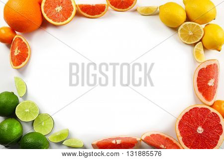 Fresh mixed citrus fruit including   lemons, limes, grapefruits, oranges and tangerines with slices, isolated on white background, top view
