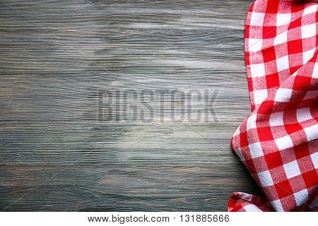 Checkered napkin on wooden background