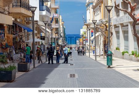 Heraklion, Greece - April 24, 2016: Central City street in Heraklion. On the main street are the shopping and tourist attractions.