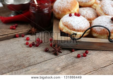 Fresh homemade donuts with powdered sugar, close up