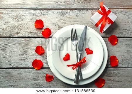 Festive table setting for Valentines Day on wooden background