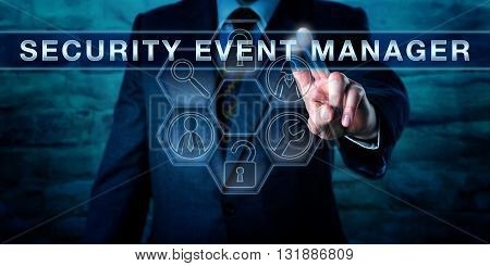 Administrator touching SECURITY EVENT MANAGER on an interactive virtual control display. Business metaphor and information technology concept for tools used for centralized interpretation of logs.
