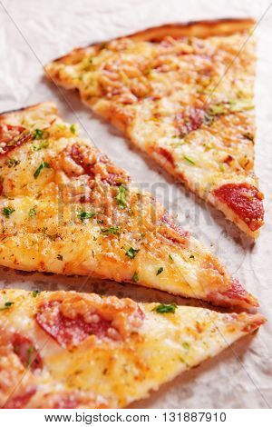 Tasty pizza on paper close up