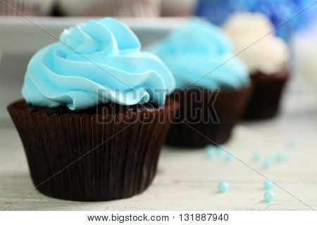 Cupcakes on wooden table