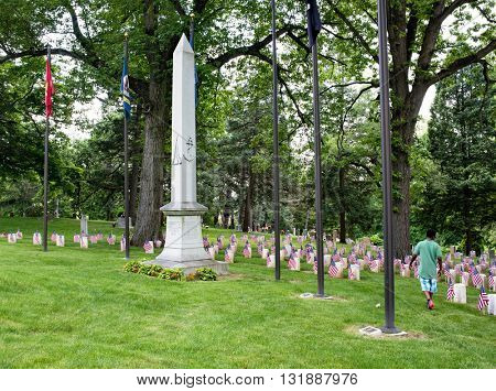 DAYTON, OHIO, USA â?? MAY 29, 2016: Young African-American boy visits Woodland Cemetery's Civil War Monument in Dayton, Ohio during the 2016 Memorial Day weekend.