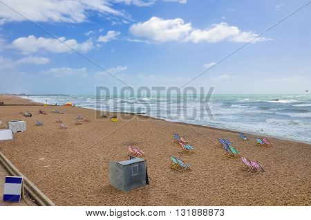 Deck chairs on the empty Brighton beach United Kingdom