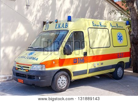 Heraklion, Greece - April 24, 2016: Yellow ambulance in the center of the capital of Crete.