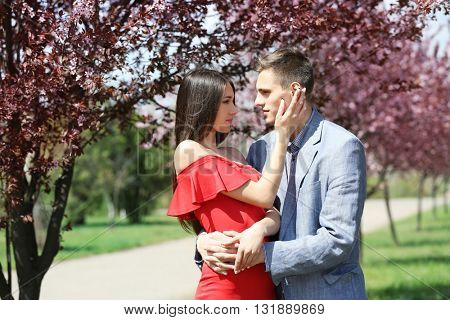 Young loving couple hugging in spring park