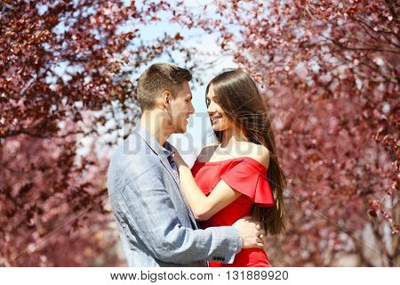 Young couple hugging in spring park