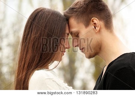 Young couple going to kiss