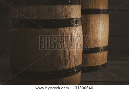 Two old wooden wine barrels, closeup, vintage
