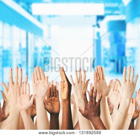 Crowd raising hands, close up