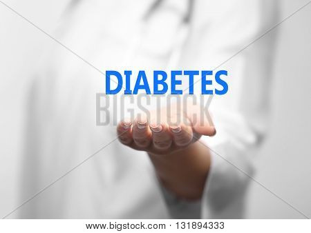 Young female doctor with text diabetes on hand