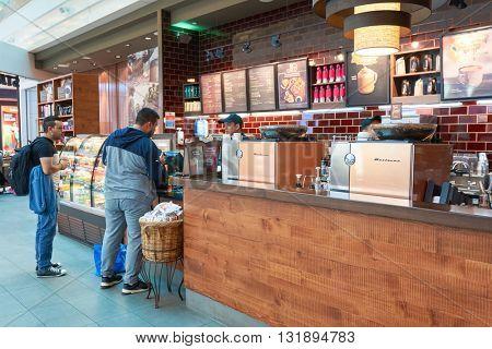 DUBAI, UAE - MARCH 09, 2016: Starbucks cafe in Dubai International Airport. Dubai International Airport is the primary airport serving Dubai, United Arab Emirates