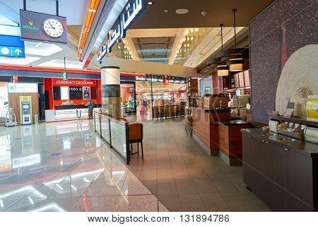 DUBAI, UAE - APRIL 08, 2016: Starbucks cafe in Dubai International Airport. Dubai International Airport is the primary airport serving Dubai, United Arab Emirates