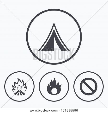 Tourist camping tent icon. Fire flame and stop prohibition sign symbols. Icons in circles.