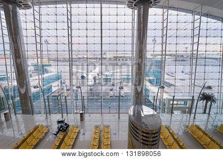 DUBAI, UAE - MARCH 09, 2016: view from Dubai International Airport Terminal. Dubai International Airport is the primary airport serving Dubai, United Arab Emirates