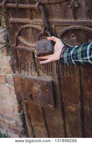 obstacle concept hand holds a lock on the door is closed