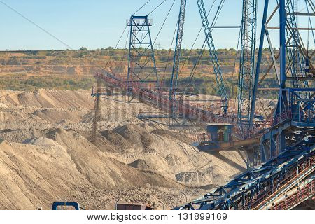 Large excavator machine in the mine working