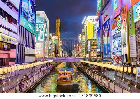 OSAKA, JAPAN - AUGUST 16, 2015: The Dotonbori Canal in the Namba District. The canals date from the early 1600's and are a popular nightlife destination.