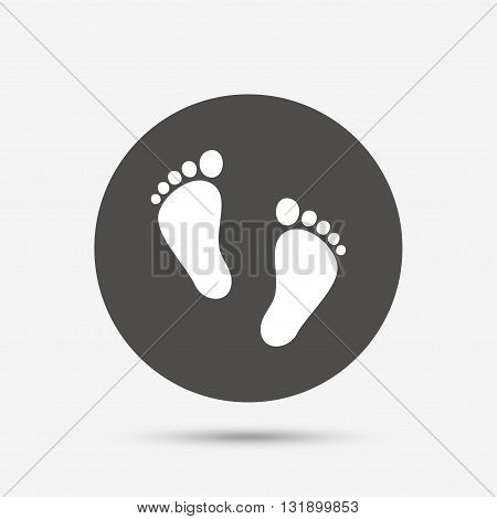 Child pair of footprint sign icon. Toddler barefoot symbol. Baby's first steps. Gray circle button with icon. Vector