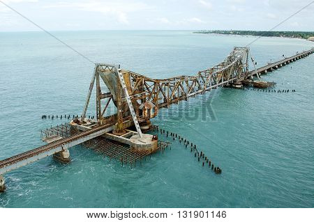 Pamban Railway Bridge near Rameshwaram in Tamil Nudu which can open up to allow ships to pass through below India Asia