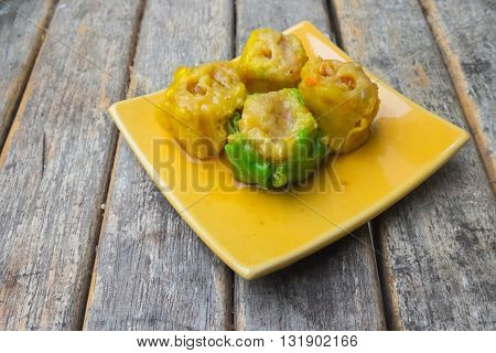 Chinese steamed dumpling or dim sum on wood table