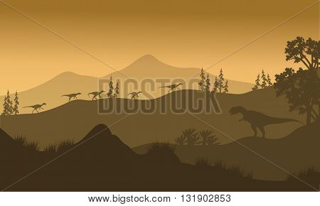Silhouette of Eoraptor and Allosaurus at the sunrise