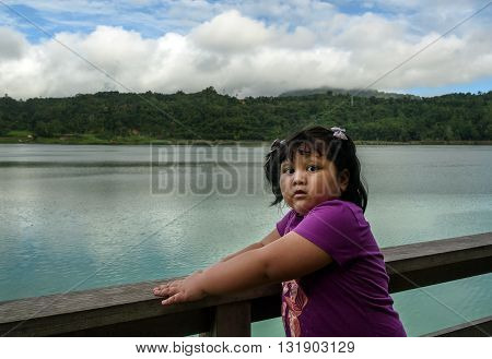 Tomohon Indonesia - Dec 23 2015: Unidentified Indonesian girl at the Linau lake in Tomohon. North Sulawesi