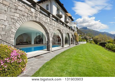 beautiful villa with indoor pool, green garden