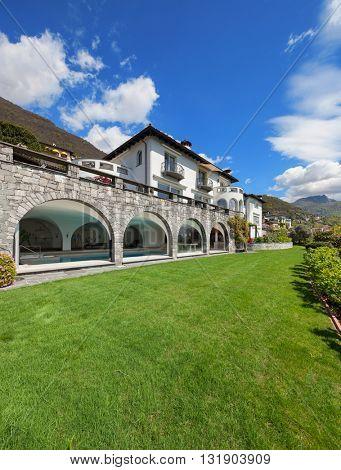 beautiful villa with indoor pool; green garden