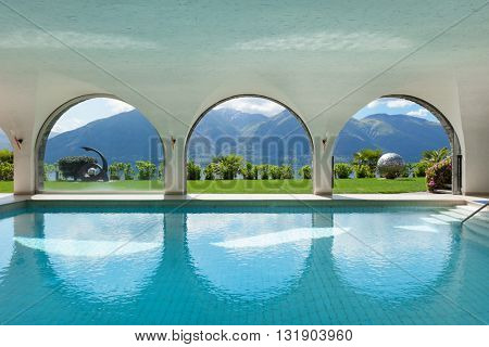 Luxury villa with indoor swimming pool, arched windows