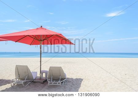 beach chair and Red Umbrella with white sand on the Bang Tao beach Phuket in Thailand